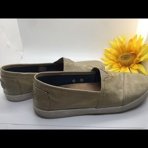 Women's Toms gold iridescent slip on loafers